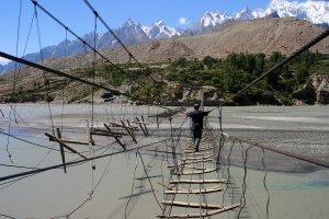 Man crossing Hussaini bridge